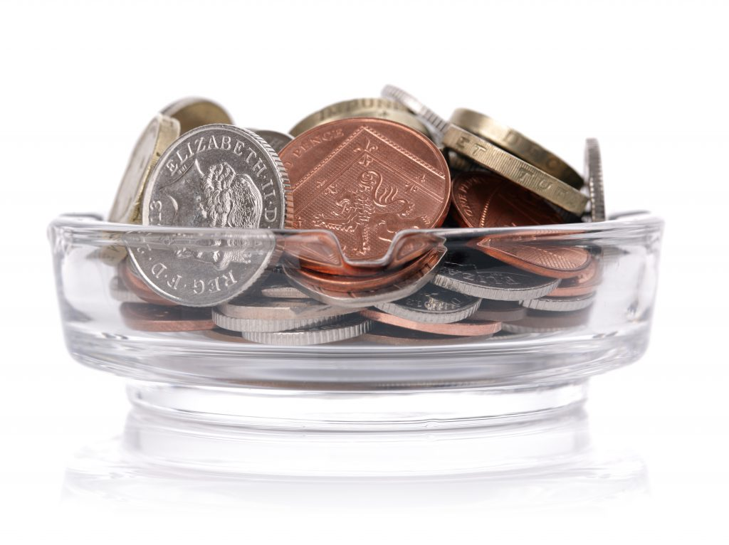 Cut Costs - UK Money In Ashtray