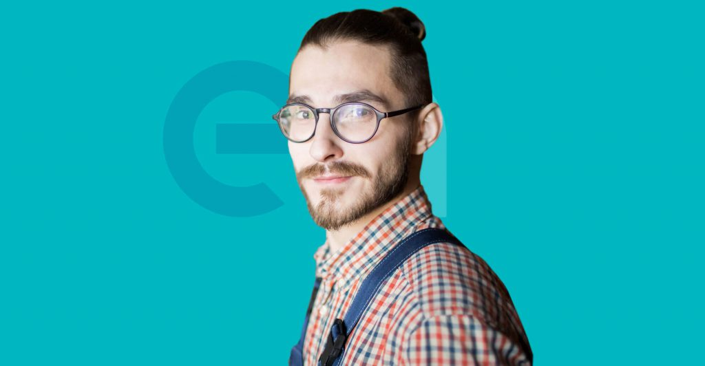 Male in dungarees and glasses with EA logo